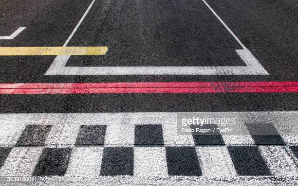 high angle view of zebra crossing on road - motorsport stock pictures, royalty-free photos & images