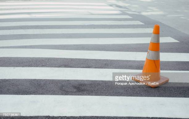 high angle view of zebra crossing on road - traffic cone stock pictures, royalty-free photos & images