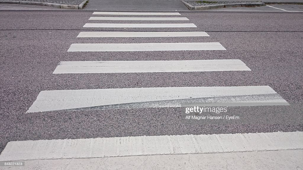 High Angle View Of Zebra Crossing On Street : Stock Photo