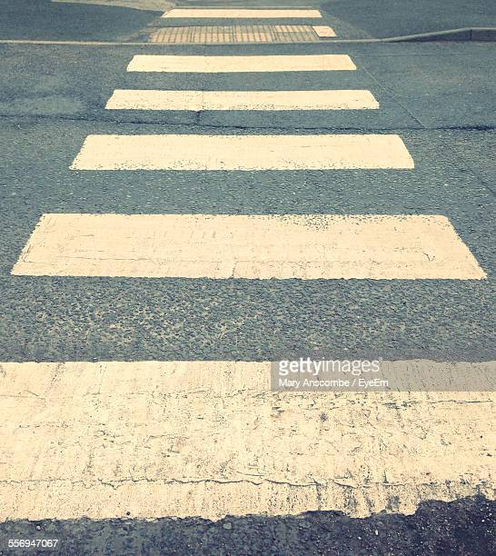 high angle view of zebra crossing on street - zebra crossing stock pictures, royalty-free photos & images