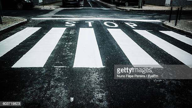 High Angle View Of Zebra Crossing With Stop Sign On Road