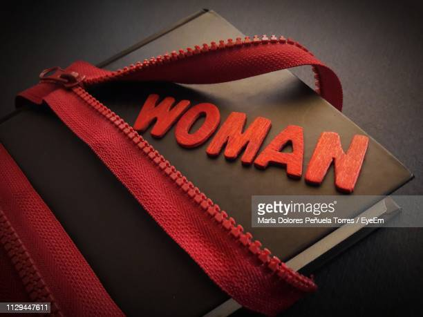 high angle view of zip and woman text on diary - international womens day stock pictures, royalty-free photos & images