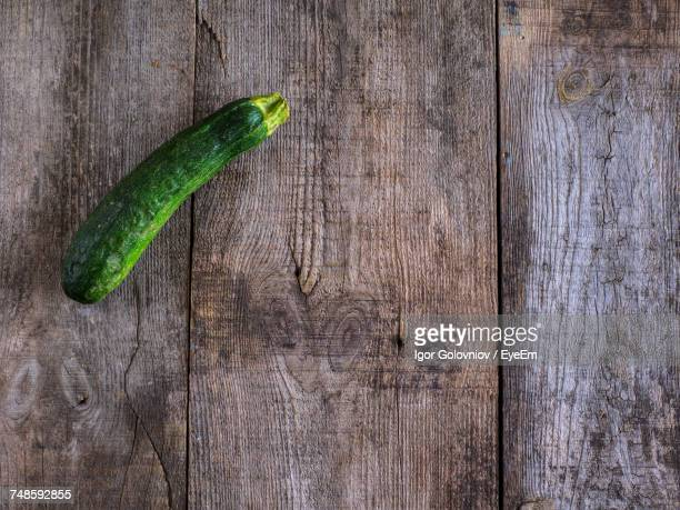 High Angle View Of Zucchini On Wooden Table