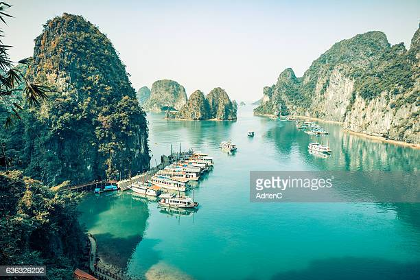 high angle view on old boats cruising around through Halong Bay