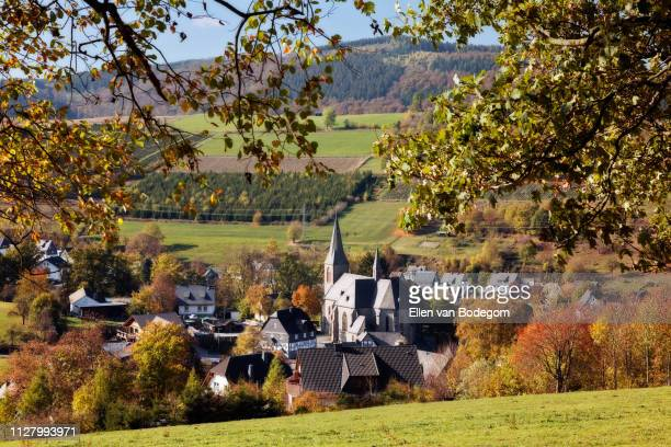 high angle view over assinghausen church in autumn - north rhine westphalia stock pictures, royalty-free photos & images