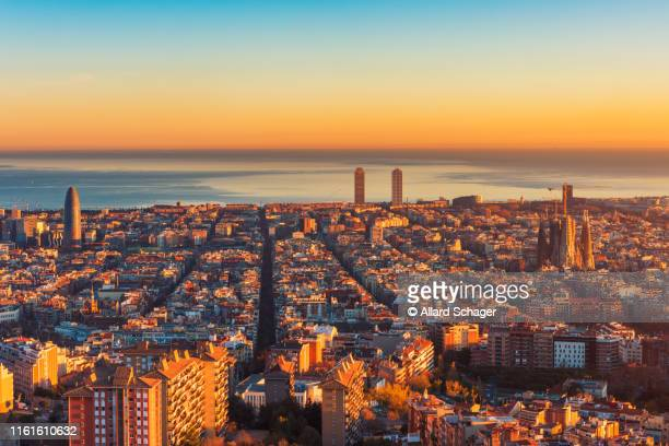 high angle view over barcelona spain at sunset - barcelona spain stock pictures, royalty-free photos & images