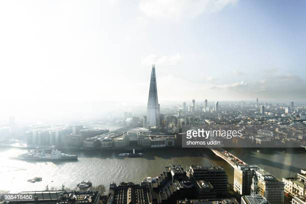 High angle view over London city against rising sun