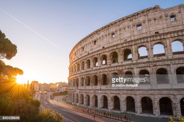 high angle view over the colosseum at sunrise. rome, lazio, italy. - rome italy stock pictures, royalty-free photos & images