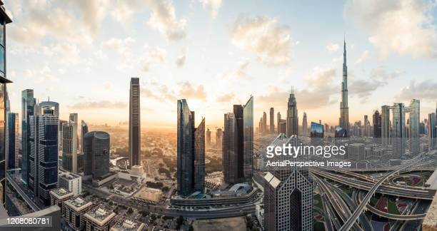 high angle view, panoramic view of dubai skyline at sunrise - dubai stock pictures, royalty-free photos & images