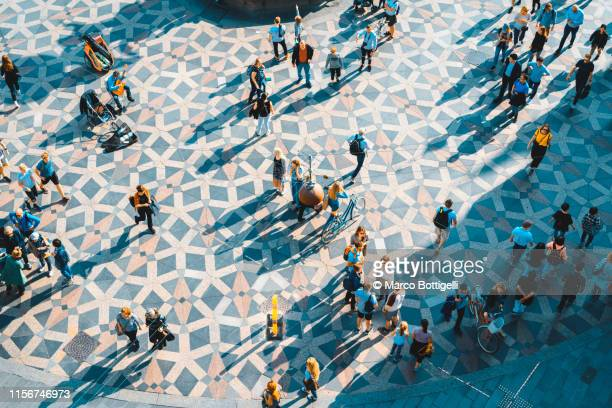high angle view people walking in amagertorv square, copenhagen denmark - copenhagen stock pictures, royalty-free photos & images