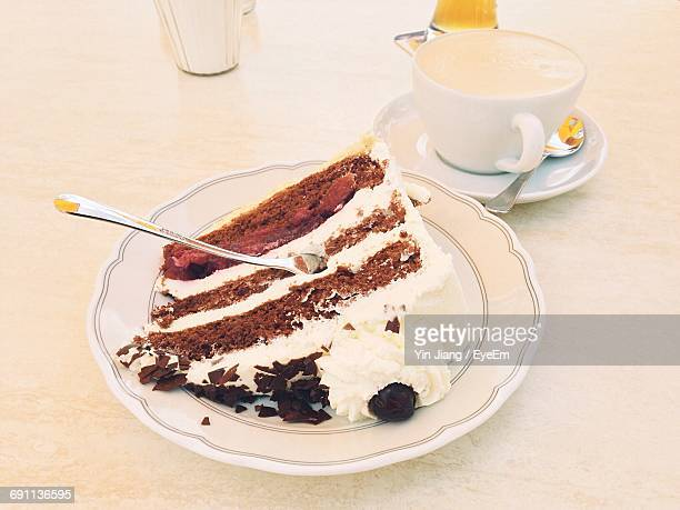 High Angle View Piece Of Cake And Coffee Cup On Table