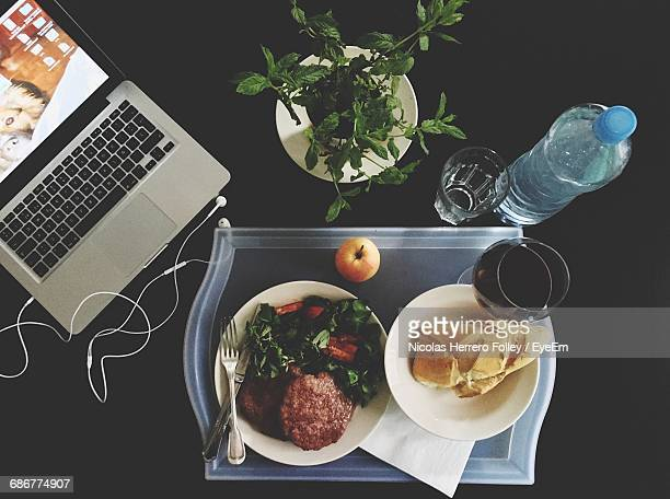 High Angle View Shot Of Meal By Laptop On Table