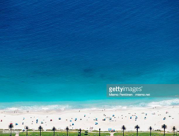High angle view to Camps Bay beach with sunbathers