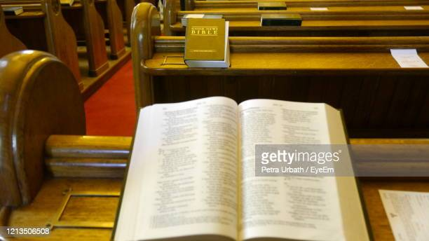 high angle view to holy bible on pew in church - scotland stock pictures, royalty-free photos & images