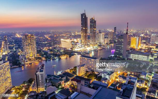 High angle view urban cityscape skyline at twilight with crowded tall buildings and river