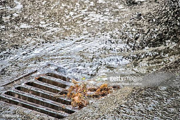 High Angle View Water Flowing In Sewer During Monsoon