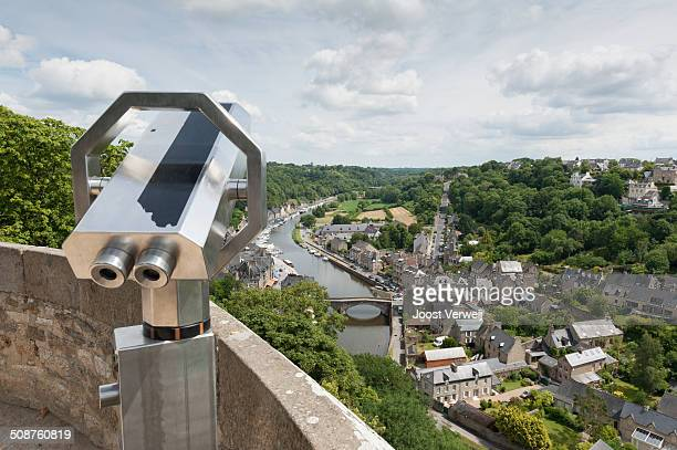 High angle viewpoint with binoculars overlooking the river Rance stone bridge at Dinan
