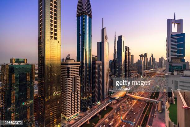 high angle views of urban skyline and skyscrapers at sunset in dubai uae. - dubai stock pictures, royalty-free photos & images