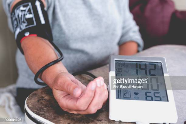 high blod pressure measured with a machine for home use - finn bjurvoll stock pictures, royalty-free photos & images