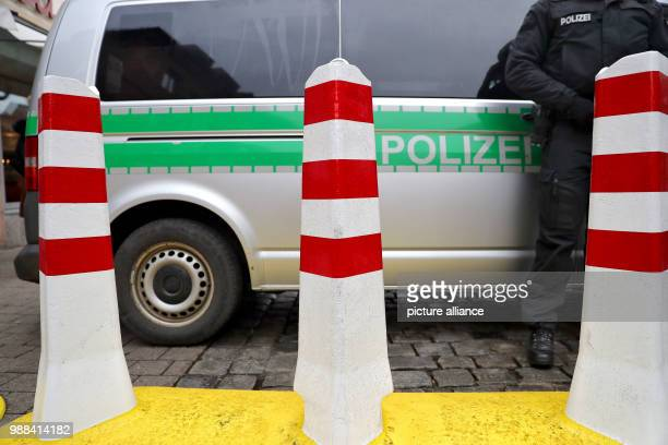 High bollards stand at the entrance area of the Nuremberg Christmas market in front of a police vehicle in Nuremberg Germany 01 December 2017 Photo...