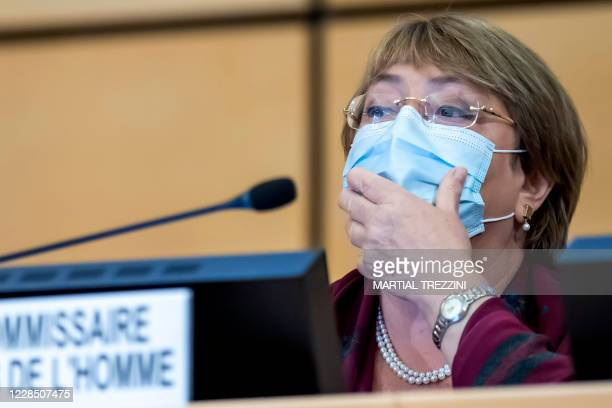 High Commissioner for Human Rights Michelle Bachelet adjusts her face mask as she attends the opening of the 45th session of the Human Rights...