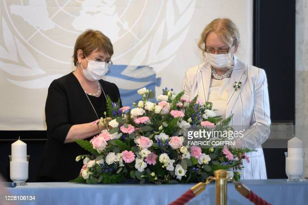 High Commissioner for Human Rights Michelle Bachelet and Director-General of the United Nations offices at Geneva Tatiana Valovaya wear protective...