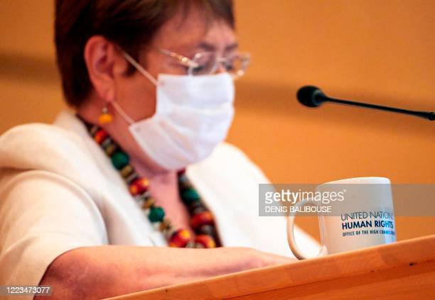 High Commissioner for Human Rights Michelle Bachelet attends the 44th session of the Human Rights Council as a mug with the High Commission for Human...