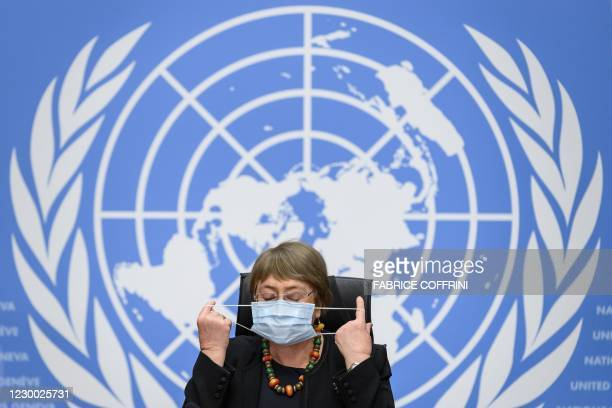 High Commissioner for Human Rights Michelle Bachelet removes her protective face mask prior to a press conference on December 9, 2020 in Geneva. -...