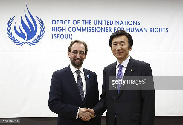 High Commissioner for Human Rights Zeid Ra'ad Al Hussein shakes hands with South Korean Foreign Minister Yun ByungSe during a opening ceremony of the...