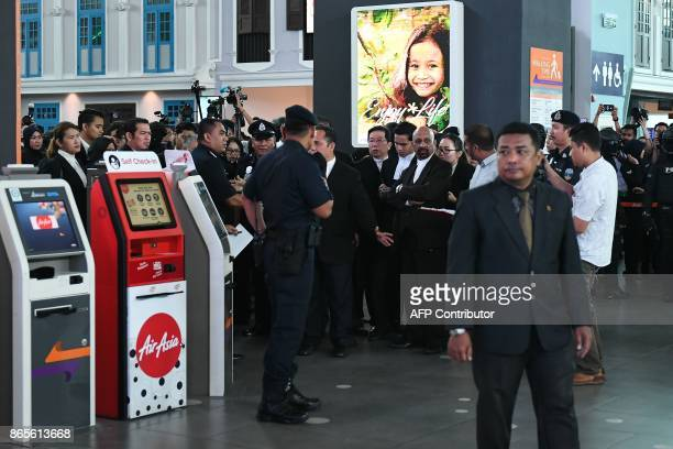 High Court judge Azmi Ariffin and lawyers for Vietnamese defendant Doan Thi Huong Naran Singh arrive at the lowcost carrier Kuala Lumpur...