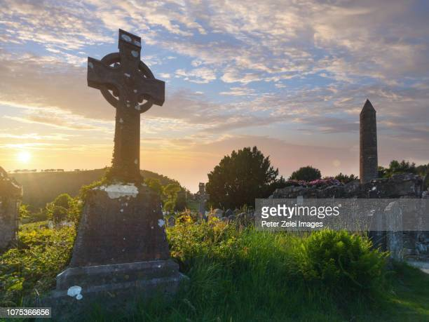 High Cross and round tower in Glendalough monastic site, County Wicklow, Ireland