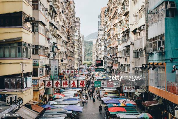 High density residential buildings and local street markets in Mong Kok, Hong Kong