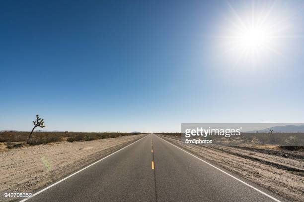 high desert highway road vanishing point - clear sky stock pictures, royalty-free photos & images
