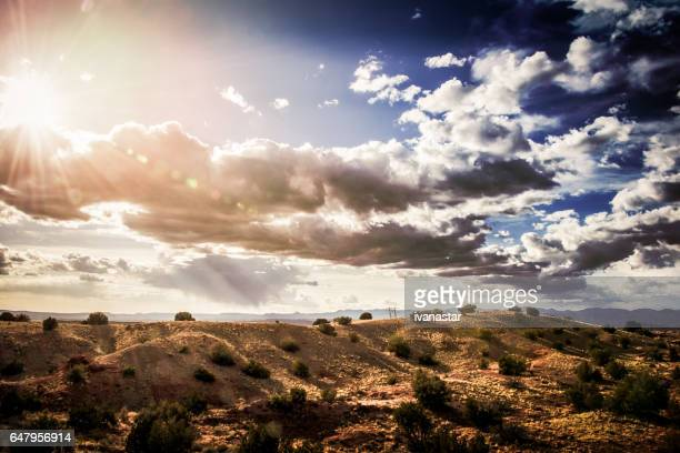 high desert sunset with blue sky and fluffy clouds - sandia mountains stock pictures, royalty-free photos & images