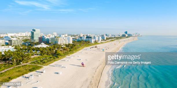high drone panoramic view of south beach in miami from south pointe park, florida, usa - miami beach south pointe park stock pictures, royalty-free photos & images