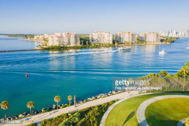 high drone view of miami canals, south beach, florida at sunrise - fisher island stock pictures, royalty-free photos & images