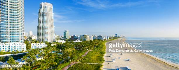 high drone view of south beach in miami from south pointe park, florida, usa - miami beach south pointe park stock pictures, royalty-free photos & images