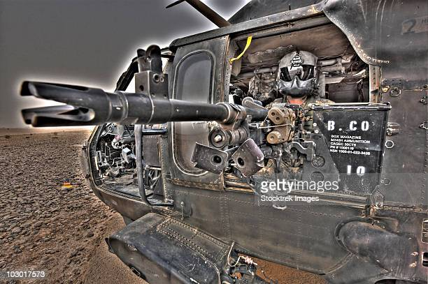 A high dynamic range image of a UH-60 Black Hawk door gunner manning a M240G medium machine gun.