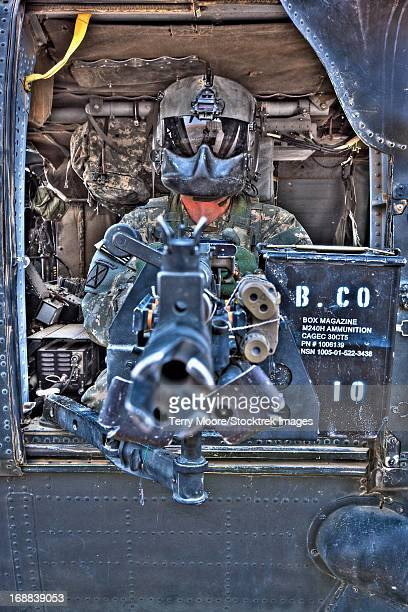 High dynamic range image of a UH-60 Black Hawk door gunner manning a M240B machine gun, Tikrit, Iraq.