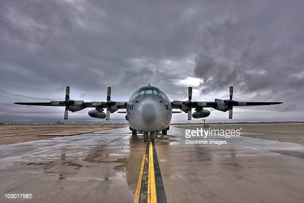 High dynamic range image of a U.S. Air force C-130 Hercules taxiing as a storm passes by.