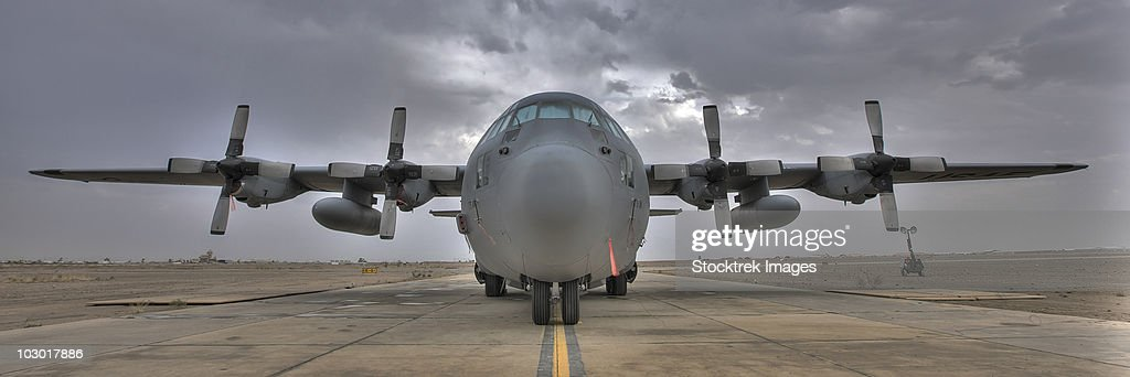 High dynamic range image of a U.S. Air Force C-130 Herucles on the tarmac at COB Speicher, Iraq. : Stock Photo