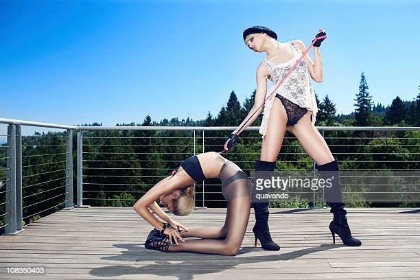 beautiful sexy haute couture fashion models outdoors doing yoga - black boot stock pictures, royalty-free photos & images