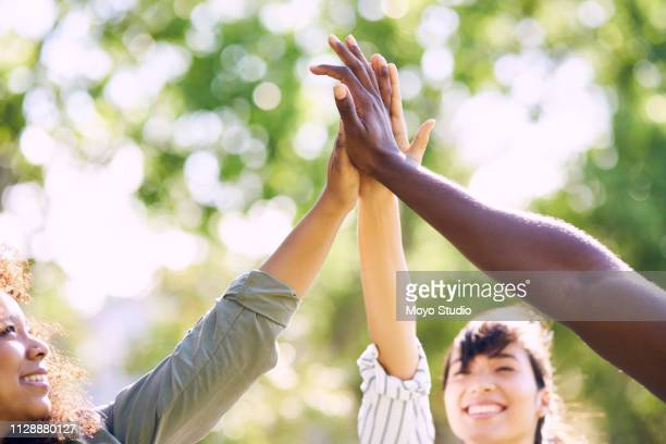 high five for a joyous day in the park - in the park day 3 imagens e fotografias de stock