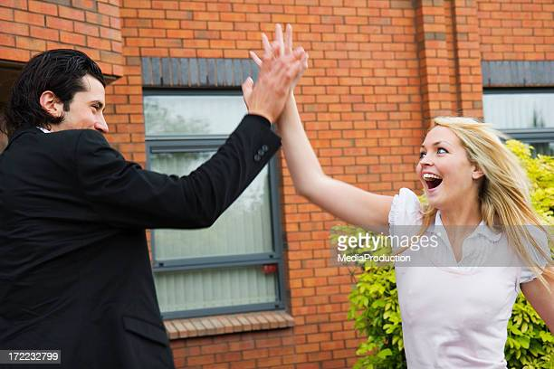 high five - heterosexual couple stock pictures, royalty-free photos & images