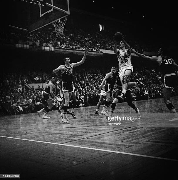 Boston Tommy Heinsohn drives in to score during second quarter action of NBA championship round with the Minneapolis Lakers at Boston Garden Lakers'...