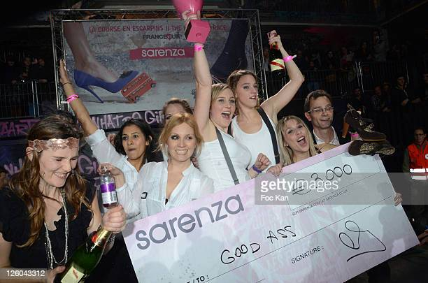 A High Heel Race participant and the prized girls from the 'Good Ass' High Heel racing team attend the 'High Heel Race' Hosted by Sarenza Shoes at...