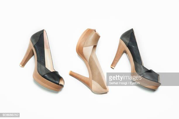 high heel shoes over white background - calzature nere foto e immagini stock