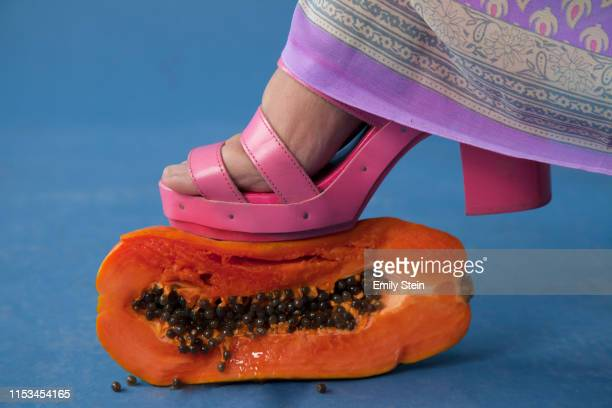 high heel squashing guava - indian female feet stock pictures, royalty-free photos & images