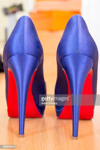 High heeled shoes of blue colour with red sole. 2013 January.
