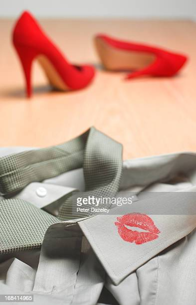 High heels and lipstick on collar